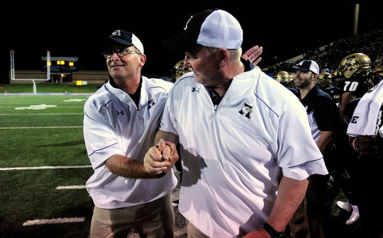Abilene High head coach Del Van Cox (left) celebrates with defensive coordinator Mike Fullen after the Eagles' 31-24 win over San Angelo Central in 2015 at Shotwell Stadium.