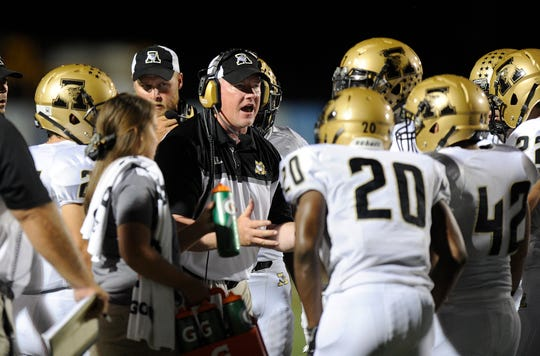 Abilene High coach Mike Fullen, center, was the Eagles defensive coordinator for years, seen here talking to his players during a 2015 game in Bedford.