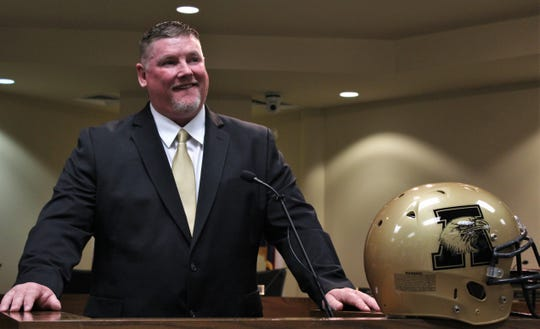 New Abilene High football coach and Athletic Director Mike Fullen takes questions after being introduced Monday.