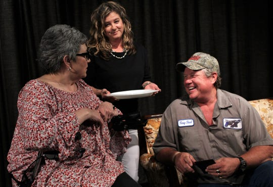 """Lucille (Tracy Brown, standing), listens in to what Ray-Bud (Rodger Brown, right) is telling Raynelle (Dana Floehr) in this rehearsal scene from """"Dearly Departed,"""" Abilene Community Theatre's 2018-19 season-ending show."""