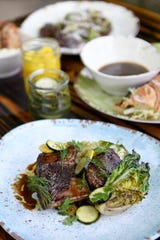 The beef short rib at Curragh Chase is grilled with charred lettuce and torn herbs.