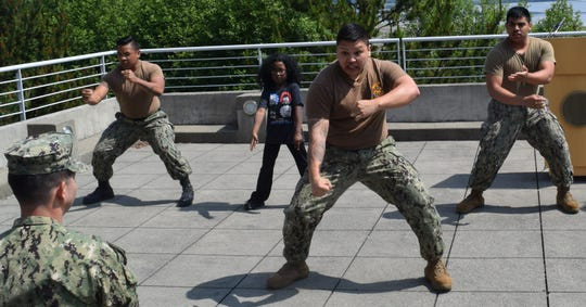 In this file photo, Naval Hospital Bremerton's Asian American and Pacific Islander Heritage Month ceremony was highlighted by a performance of the Tika Tonu Haka, a traditional war dance from the Maori people of New Zealand. The Association of Asian Pacific Community Health Organizations say Pacific Islanders are disproportionately affected by COVID-19 in some parts of the United States.