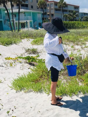 Beth Lambdin of Cocoa Beach picks up trash on local beaches.