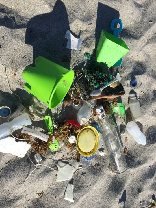Beth Lambdin of Cocoa Beach picks up trash at local beaches.