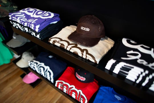 T-shirts and caps on display at the GO(O)D Company Apparel store in the Over-the-Rhine neighborhood of Cincinnati on Monday, June 3, 2019. GO(O)D Company Apparel has been open in OTR since November 2018 and sells a variety of apparel and lifestyle products.