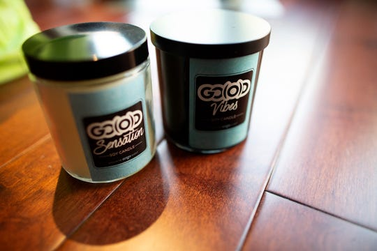 Original scented candles on display at the GO(O)D Company Apparel store in the Over-the-Rhine neighborhood of Cincinnati on Monday, June 3, 2019. GO(O)D Company Apparel has been open in OTR since November 2018 and sells a variety of apparel and lifestyle products.