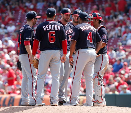 Jun 2, 2019; Cincinnati, OH, USA; Washington Nationals manager Dave Martinez (4) talks with starting pitcher Max Scherzer (31) during the eighth inning against the Cincinnati Reds at Great American Ball Park. Mandatory Credit: David Kohl-USA TODAY Sports