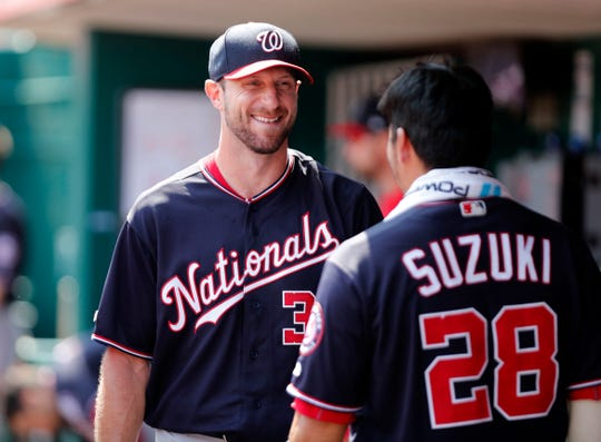 Jun 2, 2019; Cincinnati, OH, USA; Washington Nationals starting pitcher Max Scherzer (31) talks with catcher Kurt Suzuki (28) following the eighth inning against the Cincinnati Reds at Great American Ball Park. Mandatory Credit: David Kohl-USA TODAY Sports