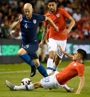 United States midfielder Michael Bradley (4) avoids the tackle of Chile midfielder Diego Valdés (10) during the second half of an international friendly soccer match, Tuesday, March 26, 2019, in Houston. The match ended in a 1-1 draw.