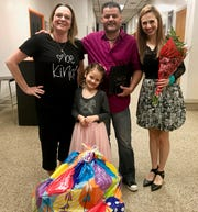 Linden teacher Kim Kefalas with School No. 8 kindergartner Anna Brum and her parents, Marcio and Camila.