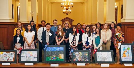 Top row (left to right): Erin Hanlon, Ocean City High School; Akansha Joshi, West Windsor Plainsboro High School South; Elijah Cochran, Ocean City High School; Benjamin Fernandez, Newmark High School (Scotch Plains); New Jersey Department of Human Services Commissioner Carole Johnson; Darielle Moore, Piscataway High School; Assistant Director of the Office of Child Support Services Patricia Risch; Mackenzie Jack, Hackettstown High School; Natasha Johnson, director of the New Jersey Department of Human Service's Division of Family Development; and Jenna Clayton, Wall High School. Bottom row (left to right): Jolie Wong, Academy 1 Middle School (Jersey City); Lois Kim, Cliffside Park Middle School; Wellington Ochoa, Cliffside Park High School; Blake Cregg-Wedmore, Hazlet Middle School; Zayn Jaber, Pillars Preparatory Academy (South River); Esperanza Baquedano, Emerson Middle School (Union City); Gabbriella Sebestyen, Thompson Middle School (Middletown); Alyssa Morris, Hunterdon County Polytech; and Niaymah Trent, Cliffside Park High School.