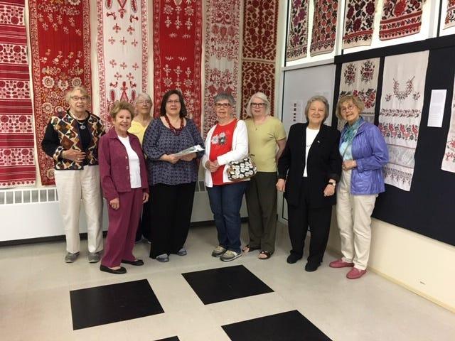 (Left to right) Marj Schindelar, Joan Jenkowski, Doris Sabin, Museum Director Natalia Honcharenko, Connie Sopko, Rosemary Saghatoleslami, Delores Gumerlock andDiane Zepp.