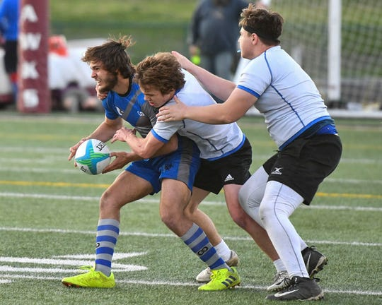 A Bondurant-Farrar players gets tackled in a match earlier this season. The Blue Jays took second in the state tournament in the team's second season.