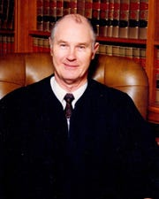 Arthur McGiverin, who was chief justice of the Iowa Supreme Court for over a decade before retiring in 2000, is seen in an undated photo provided by his family. McGiverin died Sunday, June 2, 2019.