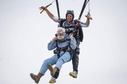 The Iowa Newspaper Association honored Register photojournalist Bryon Houlgrave with a first-place award in the Iowa Better Newspaper Contests 2020 for a series of photos he took of Ronald Mason, who at 100 was determined to skydive for the first time in the summer of 2019.