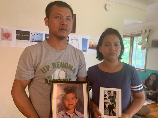 Lal Eng Zau, left, and Van Lal Ven stand with photos of their son Van Cin Lian on Monday, June 3, 2019 in Des Moines. The 13-year-old boy drown in a quarry-turned-pond on Des Moines' north side three days earlier.