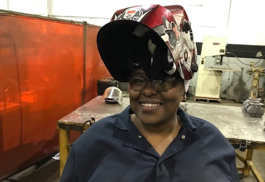 Fredrea Lakes, 29, is happy to be working at the Armored Group in Dearborn Heights, which customizes rescue vehicles for law enforcement and others. She underwent a free, six-week intensive training course through Women Who Weld.