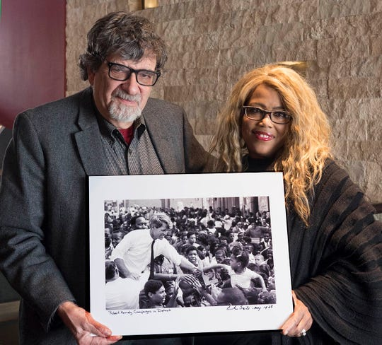 Andrew Sacks and Sybil Martin show off a photo Sacks took of Martin in May 1968, when Robert Kennedy visited Detroit.