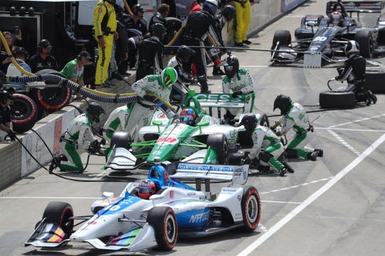 Racers head into the Pits for a tire change during the Detroit Grand Prix on Sunday, June 2, 2019, on Belle Isle.