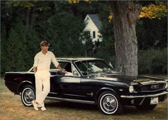 Jim Farley is pictured with the beloved '66 Ford Mustang Coupe with the 289 V-8 engine he restored himself. This photo was taken during a summer break from Georgetown University in Harbor Springs, circa 1982.