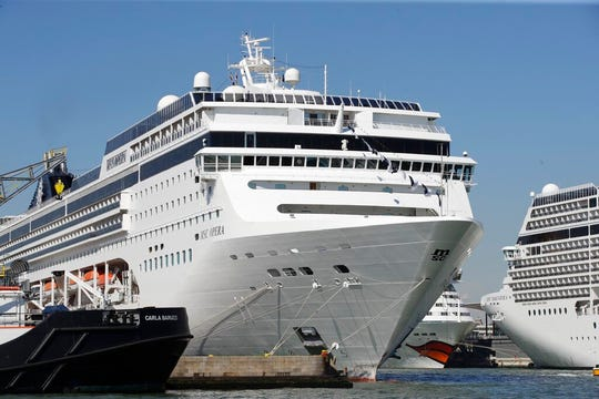 The MSC Opera cruise ship, foreground, along with other cruise ships, is moored at the Venice harbor, Italy, Sunday, June 2, 2019. The towering, out-of-control cruise ship rammed into a dock and a tourist river boat on a busy Venice canal. Italian media reported that at least five people were injured.