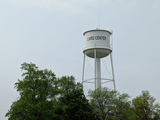 The name of the Caro Center psychiatric hospital adorns a nearby water tower in Caro, Michigan.