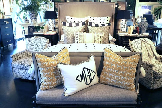 Mix and match different patterns for an interesting and textured bed display.