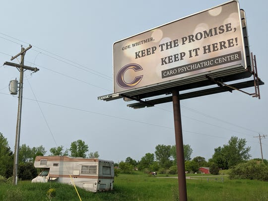 """A """"keep the promise"""" billboard paid for by Caro Community Schools."""