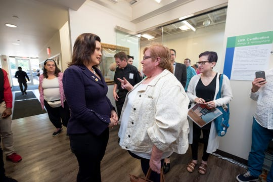Michigan Gov. Gretchen Whitmer, left, chats with Genny Maze of Royal Oak after a pride town hall meeting at Affirmations, in Ferndale, Monday evening.