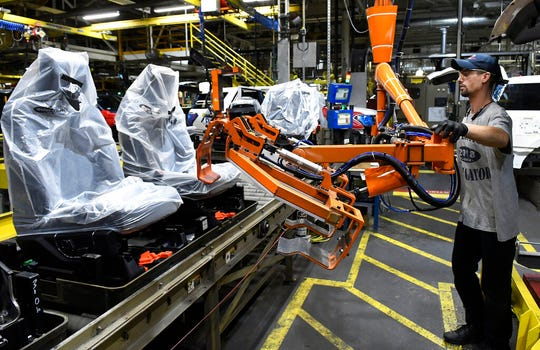 In this Oct. 27, 2017, photo, workers assemble Ford trucks at the Ford Kentucky Truck Plant in Louisville, Ky. U.S. manufacturers grew at a slower pace in May, as production levels fell slightly.