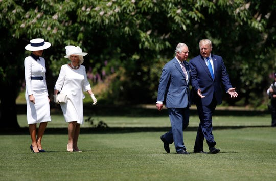 President Donald Trump walks with Prince Charles and first lady Melania Trump walks with Camilla, the Duchess of Cornwall, after arriving at Buckingham Palace, Monday, June 3, 2019, in London.