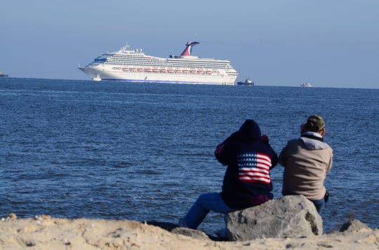 The Carnival cruise liner Triumph is seen from Dauphin Island, Alabama in this February 14, 2013, file photo. Carnival Corp. is in Miami federal court for a hearing on what to do about allegations that it has continued polluting the oceans from some of its cruise ships despite agreeing years ago to stop.