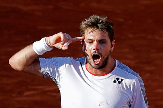 Stan Wawrinka celebrates winning his fourth-round match of the French Open against Stefanos Tsitsipas in five sets, 7-6 (8-6), 5-7, 6-4, 3-6, 8-6, at the Roland Garros stadium in Paris.