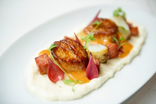 Sea scallops with masa polenta, braised bacon, and gochujang white-chocolate broth.