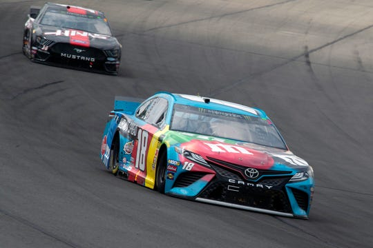 Kyle Busch, right, leads Clint Bowyer into Turn 1.