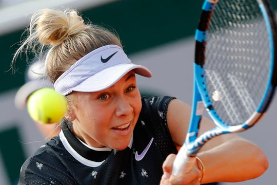 Amanda Anisimova plays a shot against  Aliona Bolsova during their fourth-round match of the French Open on Monday at the Roland Garros stadium in Paris.