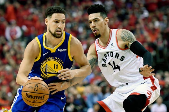 The Toronto Raptors' Danny Green  pressures the Golden State Warriors' during the first half.