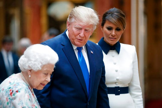Britain's Queen Elizabeth II speaks to U.S President Donald Trump and first lady Melania as they view U.S memorabilia from the Royal Collection, at Buckingham Palace, London, Monday, June 3, 2019.
