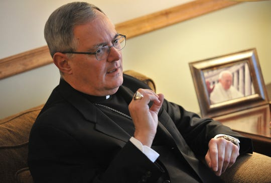 In this Nov. 22, 2009 file photo, Roman Catholic Bishop Thomas Tobin speaks to a reporter in Riverside, R.I.