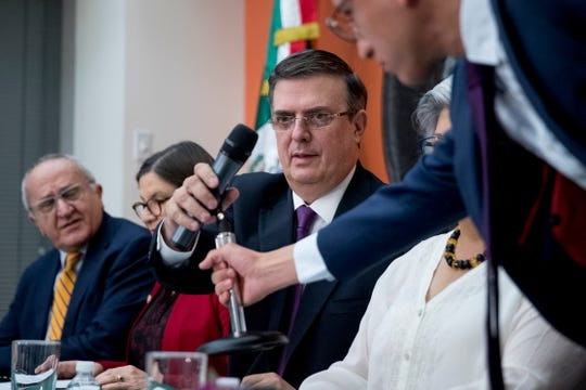 Mexican Foreign Affairs Secretary Marcelo Ebrard, center, prepares to speak at a news conference at the Mexican Embassy in Washington, Monday, June 3, 2019, as a Mexican delegation arrives in Washington for talks following trade tariff threats from the Trump administration.
