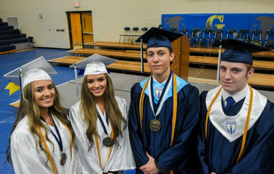 Identical twins Kayla and Maria Bolton and fraternal twins Connor and Barrett Bagby at Grass Lake High School in Jackson, Mich., on Friday, May 31, 2019.