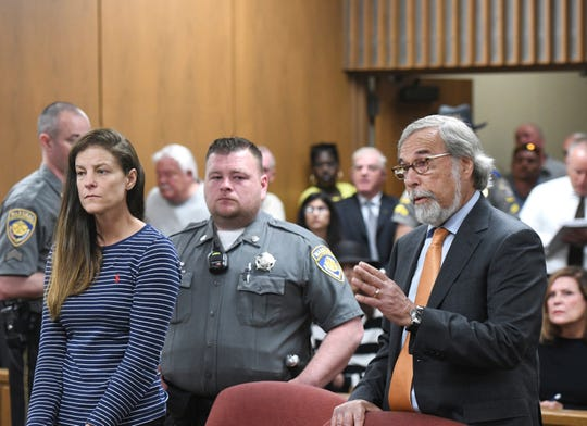 Attorney Andrew Bowman, right, speaks during the arraignment of his client Michelle C. Troconis on charges of tampering with or fabricating physical evidence and first-degree hindering prosecution.