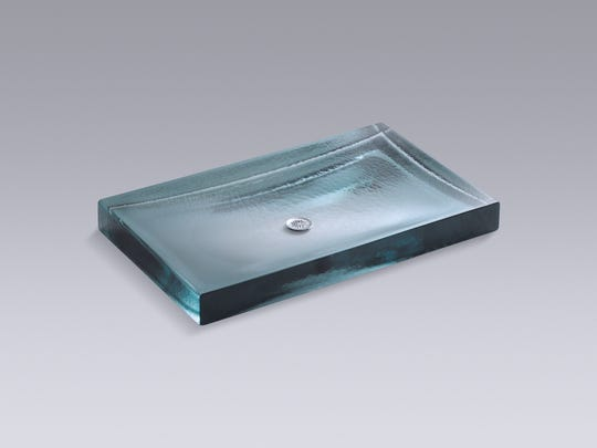 Wading pool sinks can be crafted from a large, heavy-duty piece of glass that is textured to resemble rippled water.