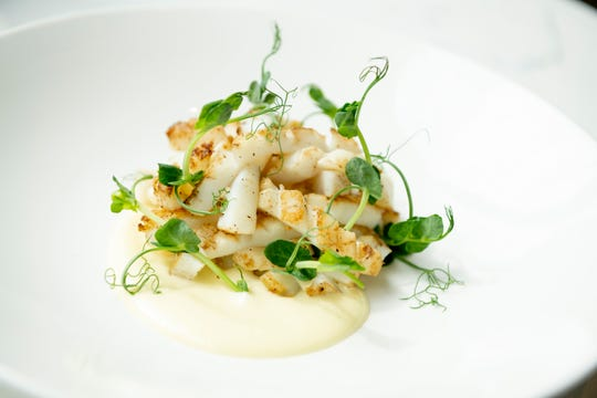 Calamari with smoky aioli and pea tendrils.