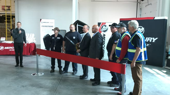 Mercury Marine leaders and employees, as well as members of the press celebrate the grand opening of the company's more than 23,000-square-foot expansion on Monday, June 3, 2019 in Fond du Lac, Wisconsin.