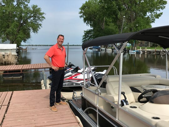 Brad Lenz, and his wife, Julie, are now renting watercraft on Lake Winnebago through their business, Lake Winnebago Boat & WaveRunner Rentals, LLC. Pictured is Brad Lenz beside two WaveRunners and a pontoon available for rent.