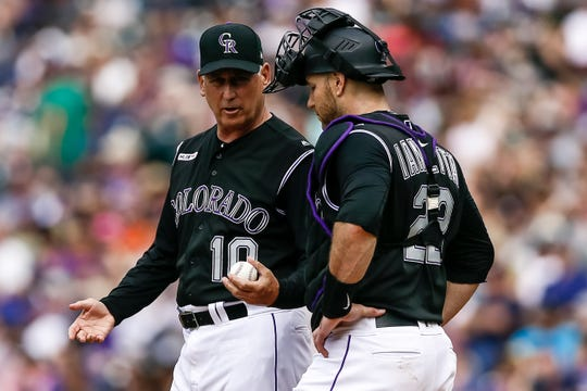 Colorado Rockies manager Bud Black talks with catcher Chris Ianetta during a pitching change in a game Sunday at Coors Field in Denver. The Rockies play the Cubs in Chicago at 6:05 p.m. Tuesday.