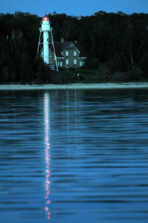 An evening view of Plum Island Lighthouse, one of the featured lights during the Door County Lighthouse Festival.