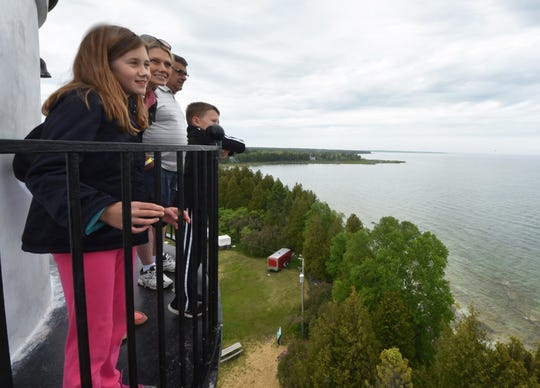 Tina Bednar of Cottage Grove, Minn., children Averi and Brady Bednar and father-in-law Bob Bednar of Austin, Minn., take in the view of Lake Michigan from the Cana Island Lighthouse tower during the Door County Lighthouse Festival.