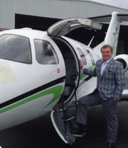 Daniel McCollum poses in front of his jet in Greenville in 2014.